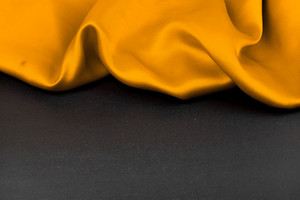 Yellow fabric on a black background