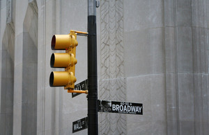 Yellow Traffic Light With Broadway Street Sign