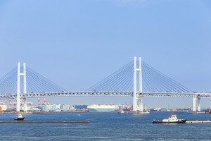 Yokohama bridge with cargo ship on sea