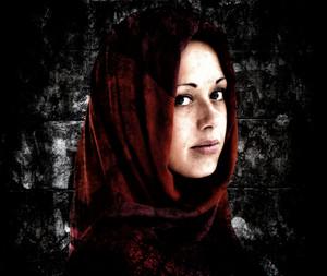 Young Arabic woman in wearing islamic scarf
