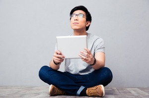 Young asian man with tablet computer