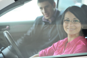 Young attractive couple driving in a car