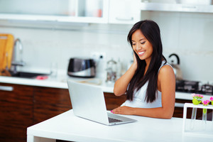 Young beautifu asian woman with laptop at home
