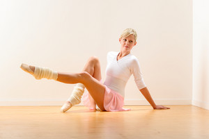 Young beautiful ballerina exercising in the studio woman ballet dancer