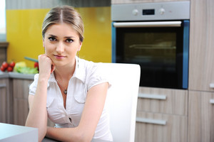 Young beautiful blonde woman in kitchen