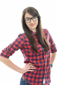Young beautiful caucasian girl in checkered shirt with glasses holding her hands on her hips isolated on white