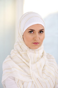 Young beautiful Muslim woman with traditional but fashionable clothes
