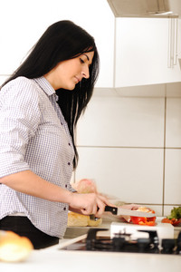 Young beautiful woman in kitchen