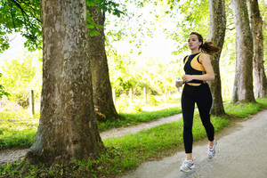 Young Beautiful Woman Jogging At Morning In Park