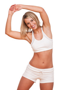 Young blond woman exercising on white background