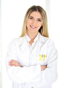 Young blonde doctor working at hospital