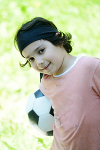 Young boy with football soccer outside