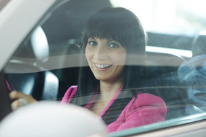Young brunette woman driving a car