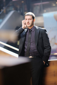 Young business man talking by cell phone