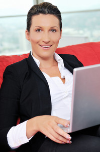 Young business woman working on laptop at home