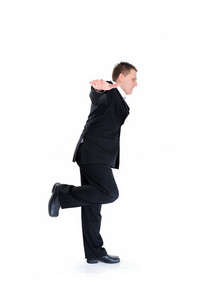 Young businessman with open arms isolated