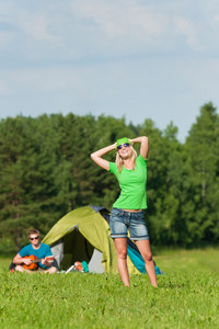 Young camping couple girl posing man play guitar sunny countryside