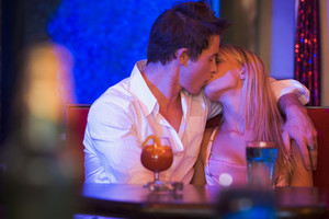 Young couple kissing in a nightclub