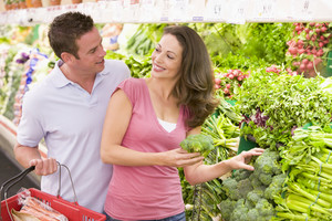Young couple shopping for fresh produce in supermarket