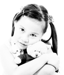 Young Cute Girl Hugging Her Teddy Bear