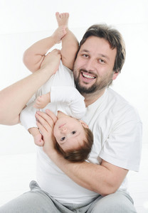 Young father playing with his little baby