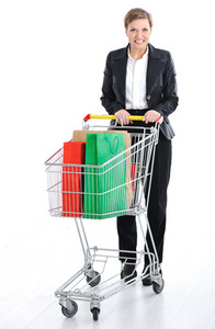 Young female pushing a shopping cart