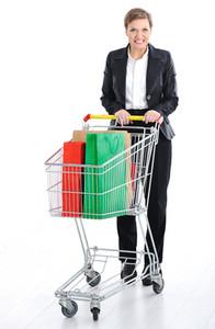 Young female pushing a shopping cart
