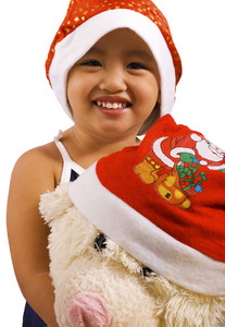 Young Girl And Soft Toy Wearing Santa Hats