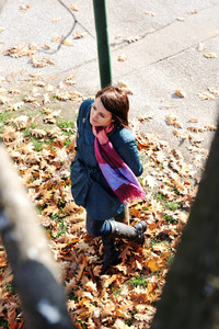 Young girl in autumn park waiting