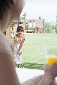 Young girl in backyard
