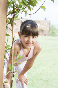 Young girl in backyard