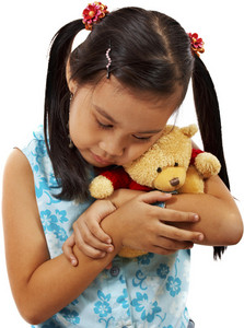 Young Girl Loving And Holding Her Teddy Bear