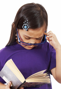 Young Girl Reading And Thinking