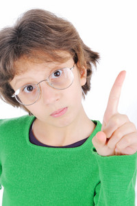 Young girl with glasses pointing her finger