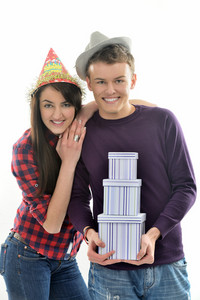 Young girl with hat leaning onto a white boy with hat holding three boxes isolated on white