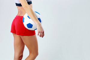 Young girls body with soccer ball over gray background