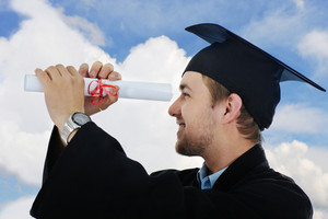 Young graduate student holding a diploma isolated with copy space