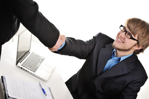 Young handsome businessman shaking hands