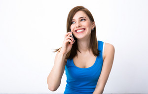 Young happy woman talking on the phone and looking away
