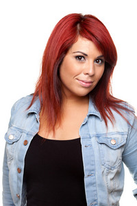 Young Hispanic woman with bright red hair head and shoulders portrait.