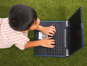 Young Kid Using His Notebook Computer