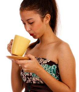 Young Lady Cooling Her Coffee