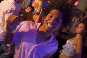 Young man dancing in a nightclub