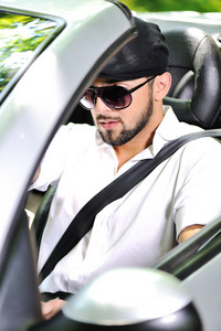 Young man driving cabriolet