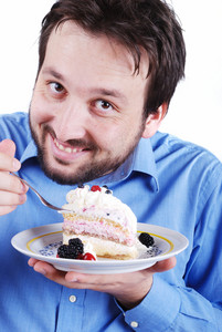 Young man eating cake