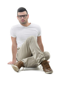 Young man in white shirt sitting on the floor