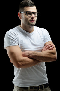 Young man in white shirt with glasses standing