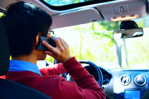 Young man on phone in car