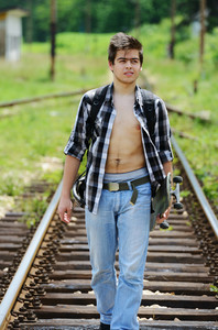 Young man on railroad