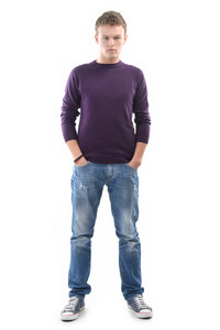 Young man posing with his hands in his pockets on white background